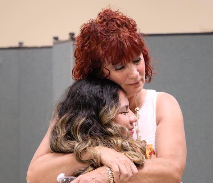 Debbie and Lady hugging at freedom