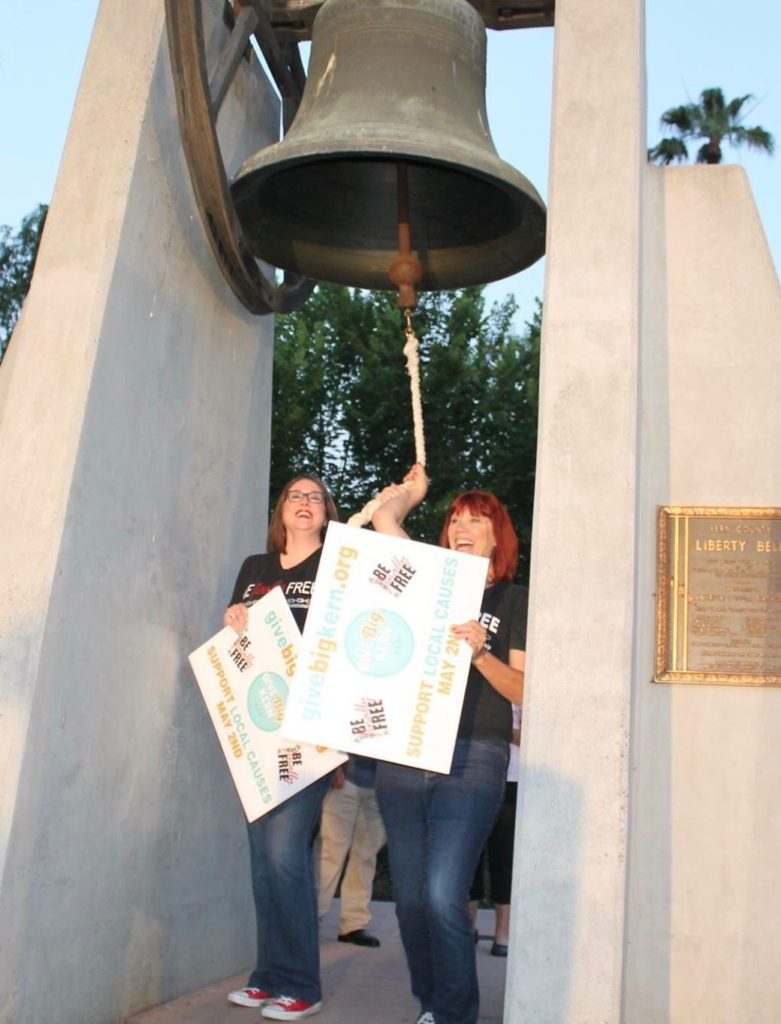 Debbie and Nikki ringing the bell
